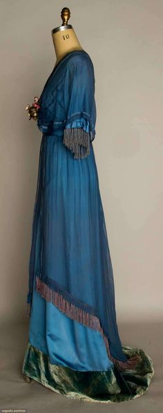 SILK EDWARDIAN EVENING GOWN, c. 1912, Powder blue silk satin w/ blue chiffon overdress, ribbon rosette trim, trained skirt w/ velvet hem band,