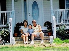 APPARITION AT THE DOOR!  In the picture are myself, my wife and my youngest son. My 14 year old son is behind the camera. The photo was taken in the summer of 2004. No one was in the house at the time of the picture being taken. I had not seen this photo until the other day when my son was thumbing thru a photo album and this ghostly figure caught his attention.