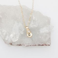 This classic, everyday necklace captures the wholeness of family and the significance of each member. This sweet necklace is hand-molded and cast in solid 10K gold. We'll hand-stamp your special initial and set a pretty little stone to