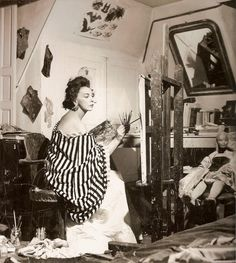Surrealist artist Leonor Fini in her Paris studio in 1952. Fini was one of the most photographed people of the 20th century. Queen of the Paris art world, she was constantly in the news - fêted for her paintings, illustrations, theatre designs and, above all, her flamboyant bohemian lifestyle. She produced the most outré art, liked to cross-dress and had a penchant for living in ménages à trois.