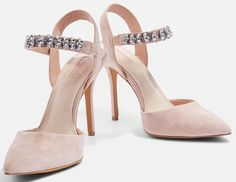 Stylish brides across the country will fall totally in love with this Topshop embellished court shoe. The dusty pink colour is beyond beautiful and the sparkly strap adds the wow-factor. These heels are totally wedding worthy and we fully envy any bride who walks down the aisle wearing them.