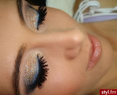 Gold shimmer eyeshadow with blue eyeliner - Would be pretty for going out on New Years Eve