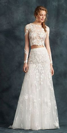 Elegant long-sleeve two piece wedding dress with tulle skirt and floral embroidered details; Featured Dress: Atelier Emé