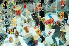 love this art installation made from hand-drawn used coffee cups