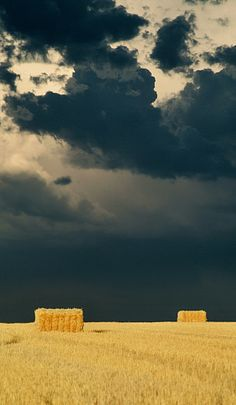 Square Hay Bales Under Storm
