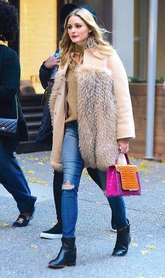 On Olivia Palermo: Max Mara coat;Storets Roa Long Sleeve Zipper Elbow Choker Pullover($72); Analeena Dynasty Bag; J Brandjeans; Isabel MarantCluster Boots($835).