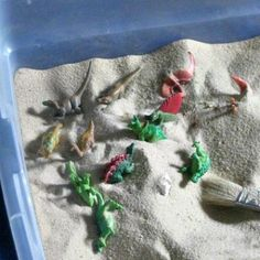 Busy Bin = Dig For Dinosaurs with a Paintbrush