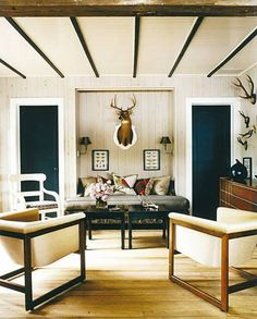 Rustic + masculine.  Thom Filicia's summer home in Skaneateles New York