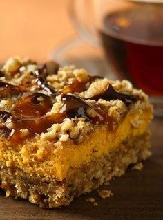 Pumpkin Streusel Cheesecake Bars Recipe ~ Chocolate and caramel drizzles add a new flavor punch to creamy pumpkin-oat bars.
