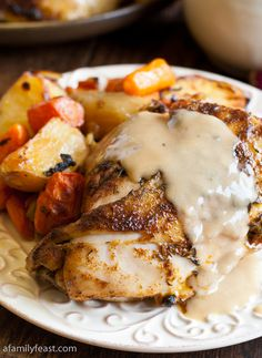Country Baked Chicken | Our country baked chicken starts with a spice rub blend of thyme, sage, paprika, garlic and a touch of cayenne, then baked with carrots, onions and celery to tender, juicy perfection.  And to top it off, a creamy, super flavorful country gravy made with a little sour cream adds the perfect finishing touch to this chicken. | From: afamilyfeast.com