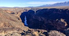 Drive 12 miles west of Taos, New Mexico on US Hwy and you'll drive directly onto the Rio Grande Gorge Bridge that spans feet. Places To Travel, Places To See, Rio Grande Gorge, Steel Bridge, Taos New Mexico, Prado, Grand Canyon, Colorado, Hiking