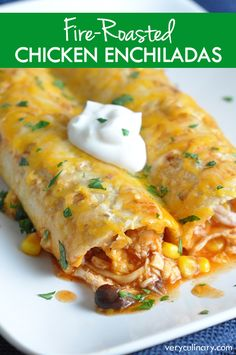 Shredded chicken, corn, beans, and cheese are rolled up in corn tortillas, then covered with homemade enchilada sauce for a delicious and comforting meal!