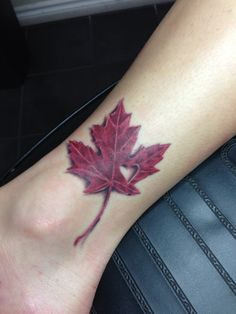 Maple leaf with heart cutout tattoo Blacky's Tattoo Studio...Done by Blacky