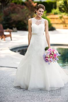 #lace dress with illusion neckline by http://www.christosbridal.com #wedding #dress Photography: Christian Oth Studio - christianothstudio.com, Florals by http://rountreeflowers.com/