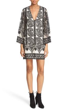 Free shipping and returns on Alice + Olivia 'Katt' Print V-Neck Caftan Minidress at Nordstrom.com. Intricate black embroidery brings a touch of exotic elegance to a leg-flaunting minidress with caftan-inspired design. A deep V-neckline and sheerness at the sleeves lighten the rich style.