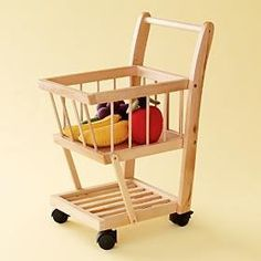 Holiday shopping calls for a shopping cart. We spotted this beauty in the Land of Nod holiday catalog recently. The Shop 'Til You Drop Cart is made of beech wood and features casters that make it easy to maneuver.