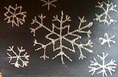 """First grade students learned to draw snowflakes. We talked about rotational symmetry and how each """"branch"""" of the snowflake should match the other branches. But we also talked about how no two snowflakes are alike, they should not feel pressure to make every snowflake """"perfect""""! They started by drawing them with pencil first, then they traced their drawings with glue and glitter."""