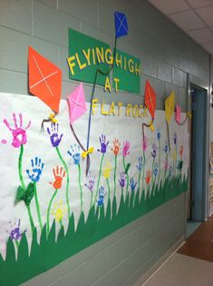 Spring kite bulletin board I created with student handprints as flowers.