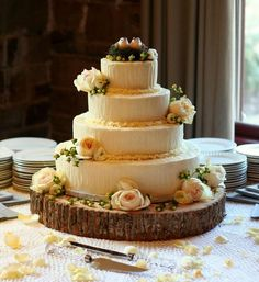 Instead of a glam metallic cake stand, try a sanded tree log for your rustic wedding. The round shape is a natural fit — in more ways than one!