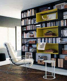 Great built in shelving design with central extended display sections. Could build this. B&B Italia shelf