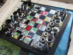 Recycled Chess board...maybe color code the board so it can double as a checkers board...Pepsi(black) vs. Coke(red)?