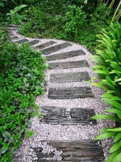 Wood plank garden pathway, lush plants, beautiful inspiration!