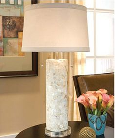 "Part Coastal - Part Contemporary, The Mother of Pearl Column Table Lamp's pieced Mother of Pearl cylindrical column sits atop a base of lucite and topped with a Neutral Drum Shade.  This beauty measures 14"" Dia x 29""H.Accepts two Type A bulbs (maximum wattage - 60 watts each) and features a Pull Chain.This item is not returnable, except in the unlikely event of defect or damage."