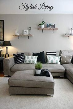 Nice sofa in cream with grey/blue footstool & soft grey wall. The ...