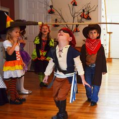 kids halloween party ideas ~ witch's broomstick limbo ~ Passion-for-Parties.com