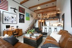 double height family room loft space, lots of great masculine touches