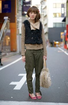 Streetpeeper.com Street Fashion Vest: Black Fuzzy Vest Sweater: Camel Sweater  Pants: Army Green Tapered Cargo Pants: Bag: Furry Bag Shoes: Pink Flats Photo By: Phil Oh