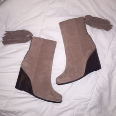 Jeffery Campbell brown suede wedge boots Never worn and they are amazing! Original lf tag on the bottom of the boot. They are little tight on my ankle/calf that is the only reason for selling! (I have big calves ) super cool fringe tassels on the back ⭐️ all offers welcome! Can provide a box also! They are listed as brown but appear more of a light brown/taupe Jeffrey Campbell Shoes Ankle Boots & Booties