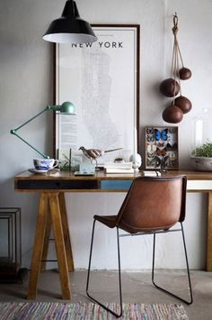 Brown tones and leather textures teamed with rich wood and dark metals create a modern look for 2015 #hotlooks #inspiration