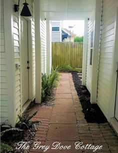 Breezeway leading from the cottage, between the detached garage, and carriage house, to the herb garden