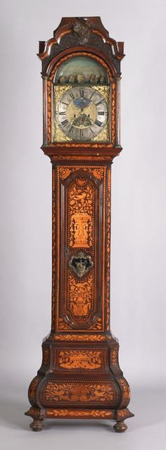 Dutch marQuetry and burl veneer tall case clock, 18th c., the sarcophagus top with blind fretwork frieze enclosing an 8-day brass face works, signed Johs Uswald Amsteldam, with dioramic rocking ship harbor scene and 2 bell mechanism, over an elaborate marquetry case with bombe base and bun feet, 94.5 H.