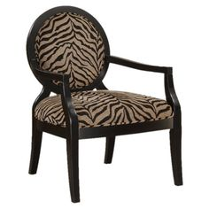 Give classic design a contemporary twist with this chic accent chair, showcasing zebra-print upholstery and tapered wood legs.    Produc...