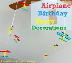 Airplane Birthday Party Decorations - a banner, clothespin planes, and candy planes