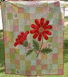 daisy patchwork quilt - I would use different colors but a beautiful pattern