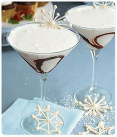 White Chocolate Martinis       ingredients   1 cup sugar   2 cups water   1/2 cup half-and-half   2 bars DCD Chef-Series White Chocolate (4 oz.), chopped   2 oz. vodka, regular or vanilla-flavored   DCD Raspberry Dessert Sauce     Tools   DCD Cocktail Shaker     PREPARATION   Preparing the Simple Syrup   1. In a saucepan, bring the sugar and water to a boil over medium-high heat, stirring constantly until sugar is completely dissolved.   2. Remove from heat and cool in the refrigerator until…
