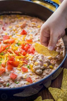 Sausage Queso Dip (with Real Cheese!) - Natasha's Kitchen - Sausage Queso Dip is creamy, cheesy and irresistibly good! A queso dip recipe with real cheddar cheese, loaded with sweet corn and tomato. Perfect for football and tailgating. Football Party Foods, Football Food, Football Recipes, Appetizer Dips, Appetizer Recipes, Yummy Appetizers, Sausage Queso Dip, Party Dip Recipes, Party Dips