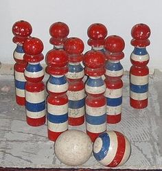 This wouldn't be hard to make. Wooden posts and balls for a vintage bowling game.