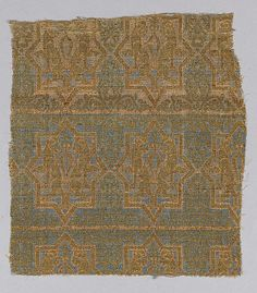 Textile Fragment from the Chasuble of San Valerius Object Name: Fragment Date: 13th century Geography: Spain Culture: Islamic Medium: Silk, gilt animal substrate around a silk core; taqueté Accession Number: 46.156.3