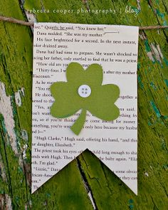 simple as that: simple st. patrick's day bunting -- little flags: text/music paper (uncial calligraphy would be amazing), felt or fabric shamrocks (texture of some sort, emily has a clover punch), buttons, maybe some trim or ricrac or glitter at bottom edge