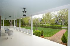 Wide front verandahs - wooden raked ceiling