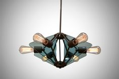 Custom Spike Lighting Chandelier #moderndesign #globelight #smokedglass #lightfixtures #chandelier #pendant #hospitalitydesign #customlighting #castbrass
