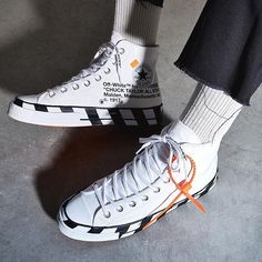 Converse teams up with Virgil Ablohs Off White on a rendition of the Chuck Taylor All Star 70 Hi finished with trademark Off White detailing. Off White Converse, White Converse Outfits, Off White Shoes, Sneakers Mode, White Sneakers, Sneakers Fashion, Socks Outfit, White Chuck Taylors, Dior Shoes