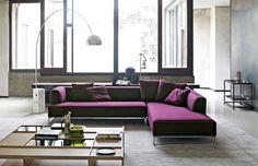 Un canapé d'angle mauve tout en modernité pour séjour design