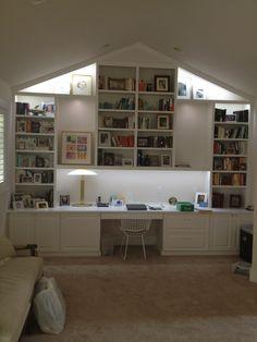 Vaulted ceiling with trim and lights. File storage, a slide out printer, adjustable book shelves. Designated lit up space for artwork. Ample storage.