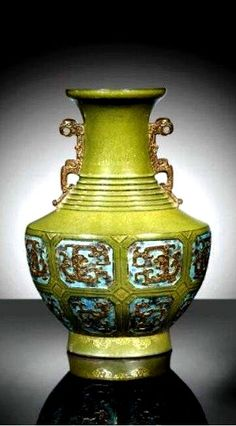 Qing Dynasty, Qianlong mark and period (1736-1795) Tea-dust Porcelain Vase, with stylized dragon decoration, inspired from archaic ritual bronze hu-form vase.