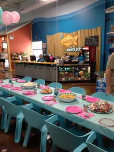 Decorated tables at Goldfish Swim School for Lindsey's first birthday party